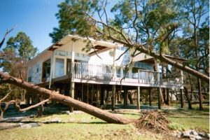 Coastal residence damaged by wind and flood