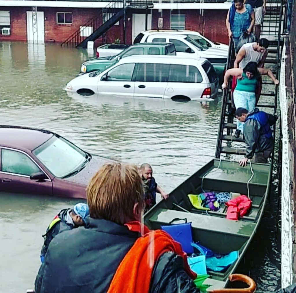 """John Minor CFM conducting rescues in Houston. This was a special rescue John is on the stairs at the bow of the boat."