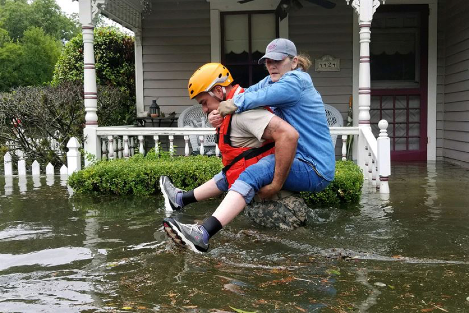 TX National Guardsman carries a resident from flooded home